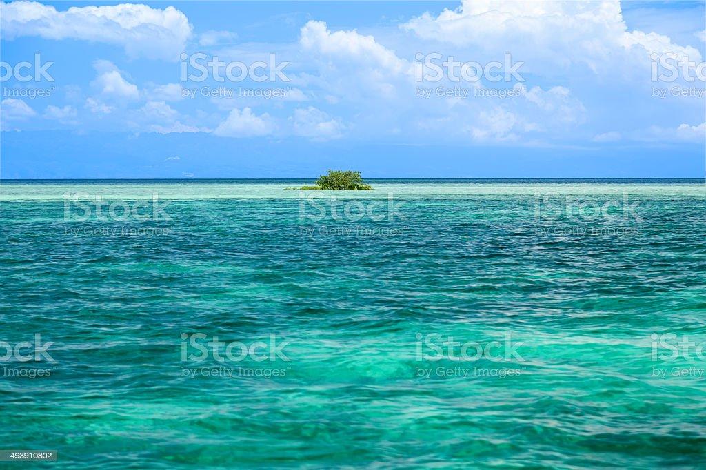 Tropischen Riff und kleinen Insel Lizenzfreies stock-foto