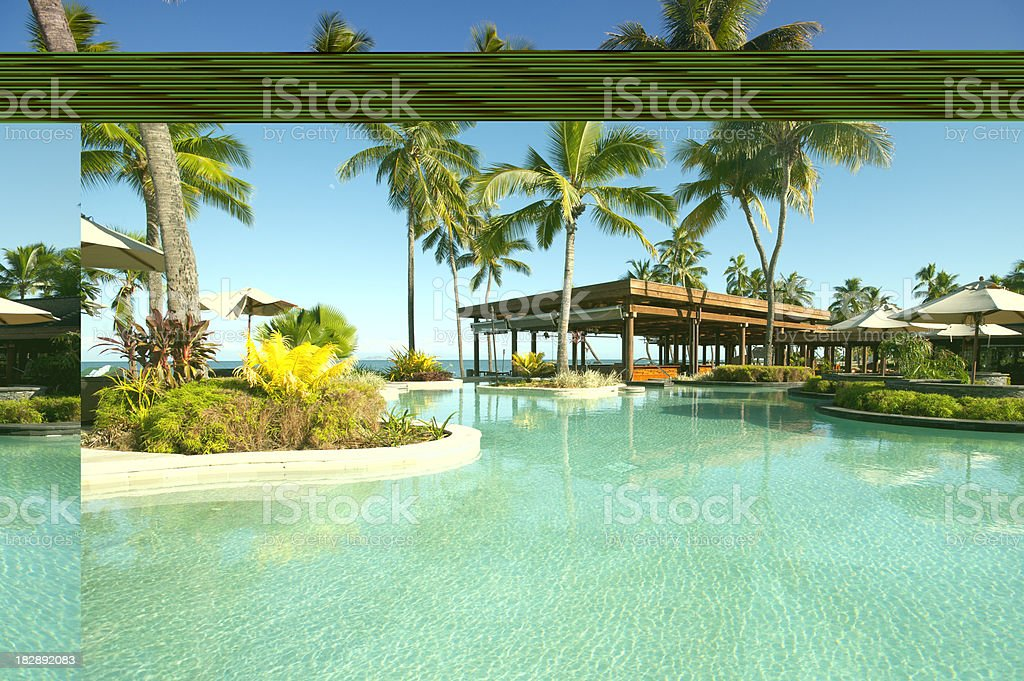 Tropical Resort pool with palm trees stock photo