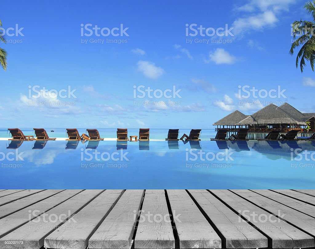 Tropical resort pool with wooden decking stock photo