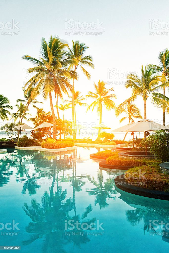 Tropical Resort Poolside at Sunset stock photo
