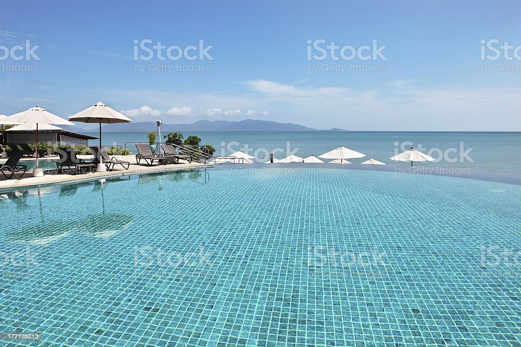 Tropical resort. Poolside with sea view royalty-free stock photo