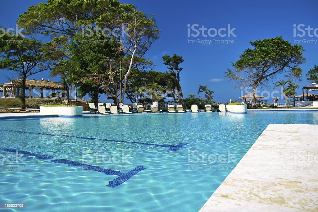 Tropical resort with swimming pool stock photo