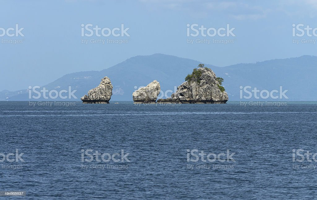 tropical rock and island in the open sea stock photo