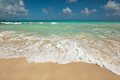 Tropical sandy beach with turquoise ocean
