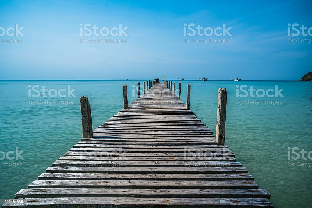 Tropical sea and wooden pier, holiday background stock photo