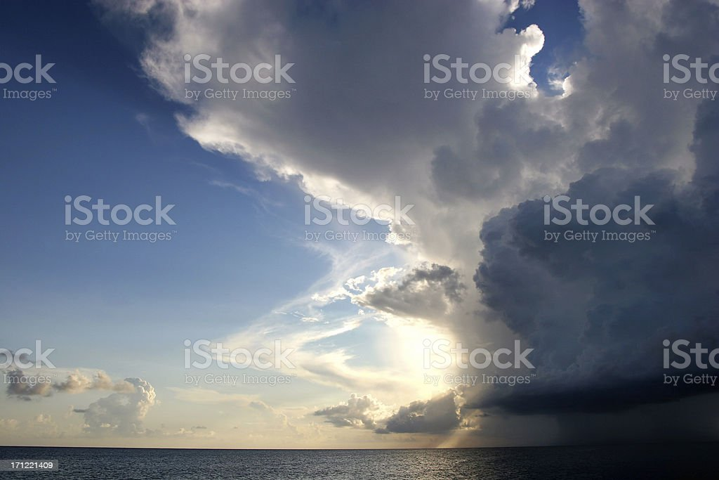 Tropical storm interrupting a beautiful sunny sky royalty-free stock photo