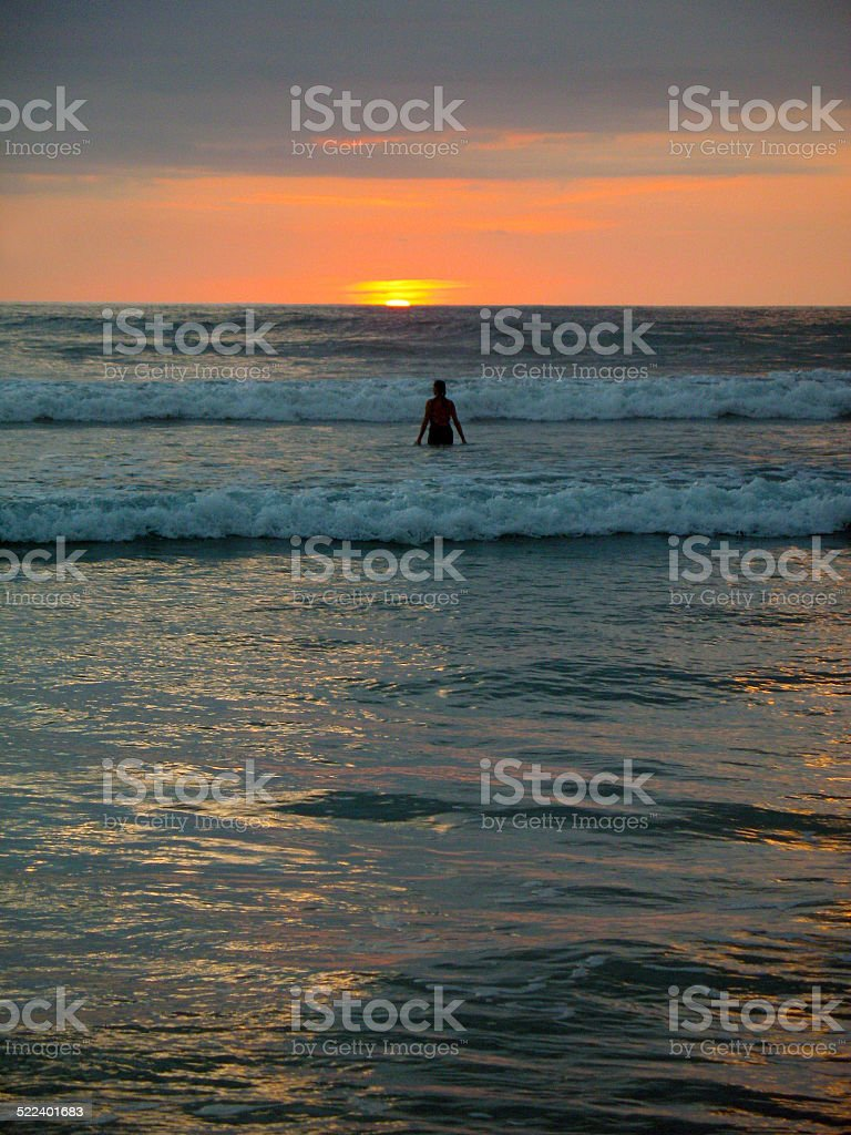 Tropical Sunset and Surf stock photo