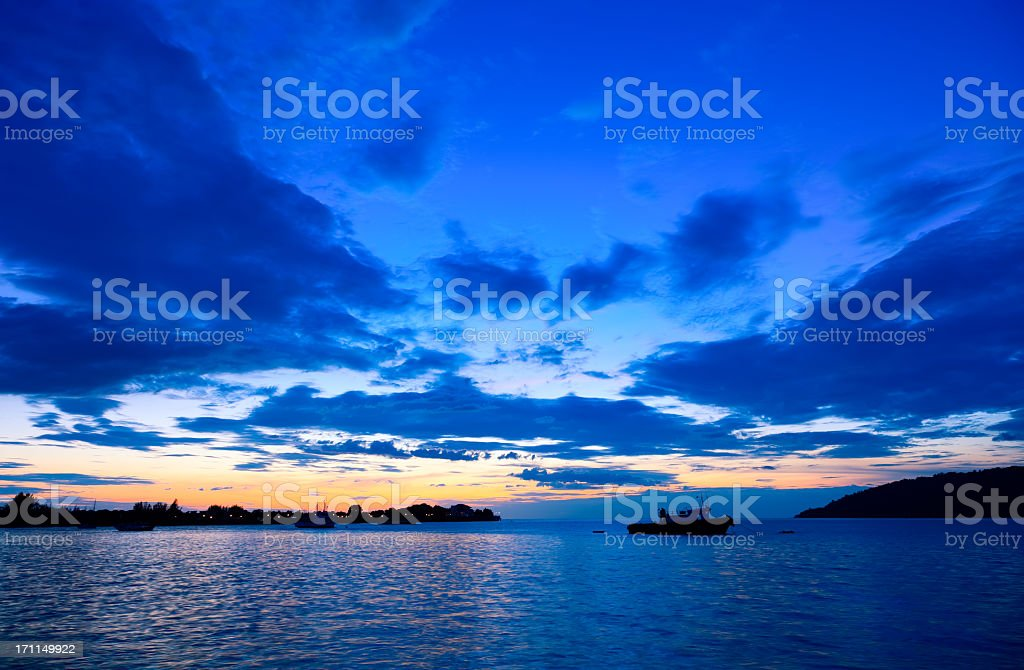 Tropical sunset on Kota Kinabalu bay stock photo