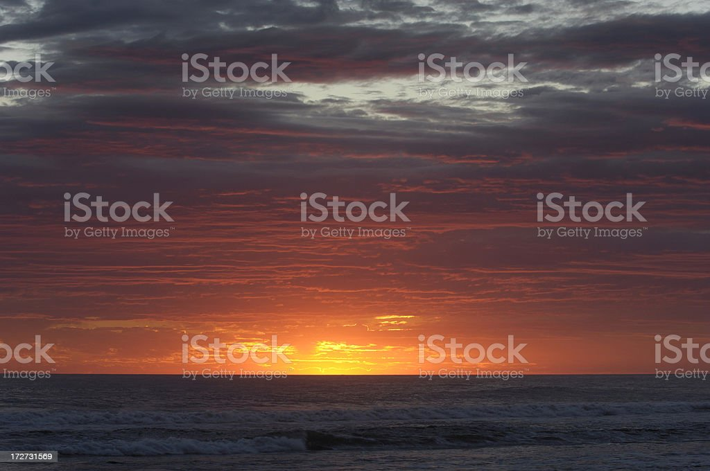 Tropical Sunset Over Pacific Ocean stock photo