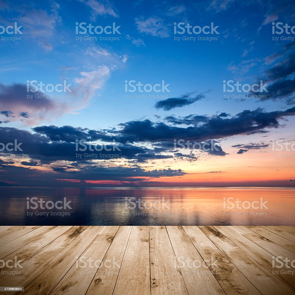 Tropical sunset with empty wooden platform stock photo