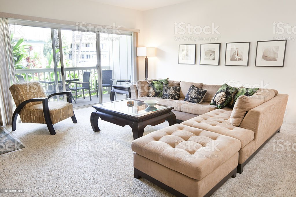 Tropical Themed Condominium Apartment Living Room and Balcony stock photo