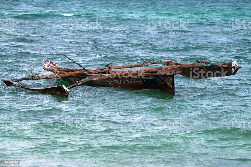 Tropical trimaran boat stock photo