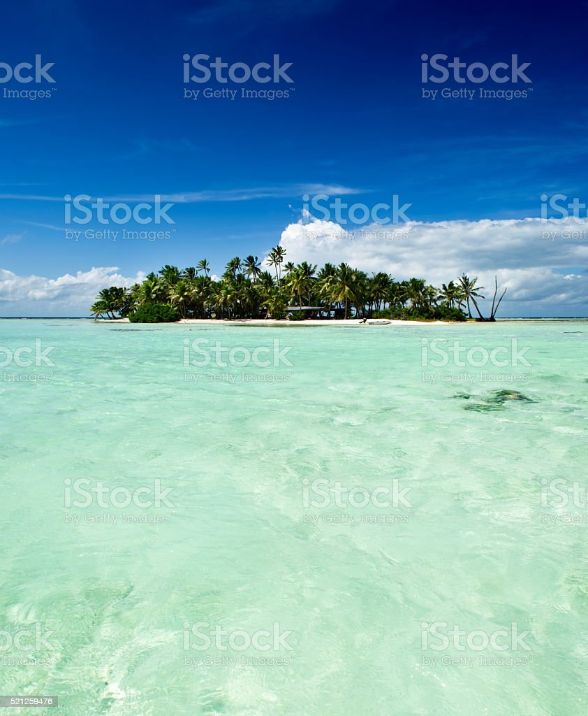 Tropical uninhabited island in the Pacific Ocean stock photo