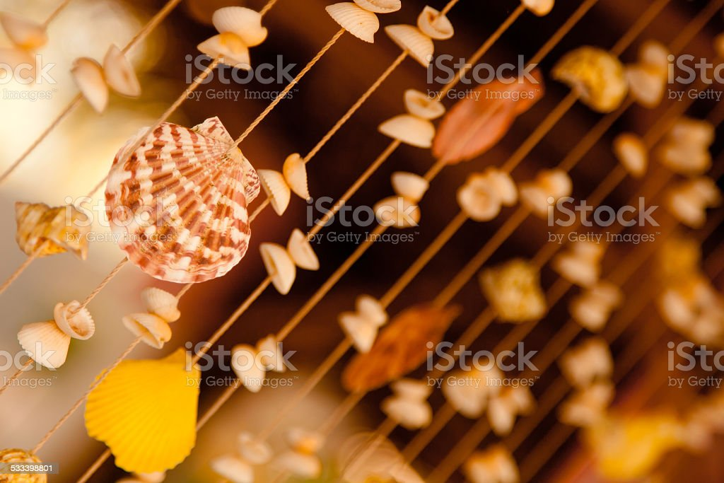Tropical vacation background with Curtain made from the sea shells stock photo