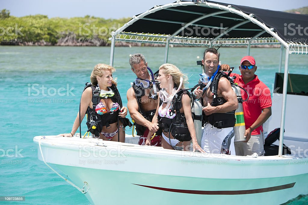 Tropical Vacation: Friends Scuba Diving royalty-free stock photo