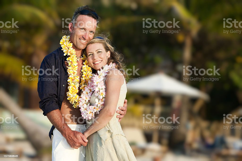Tropical Vacation: Romantic Couple on Beach royalty-free stock photo