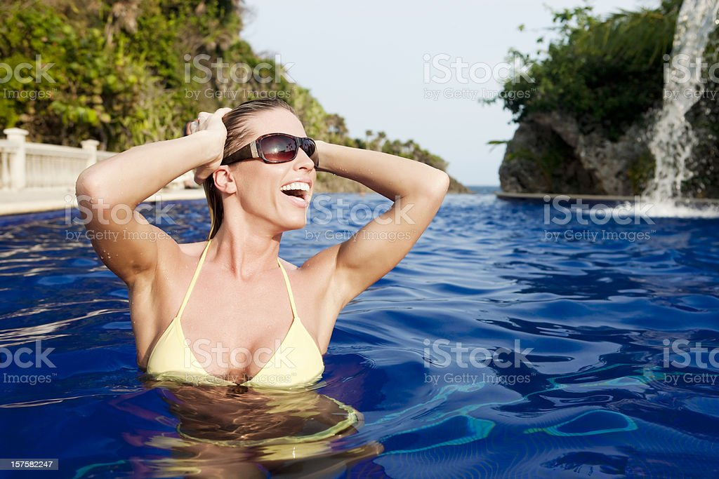 Tropical Vacation: Sexy Woman in Swimming Pool royalty-free stock photo