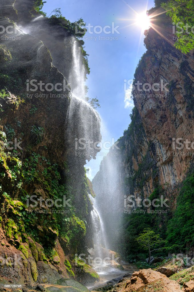 Tropical waterfall in canyon stock photo