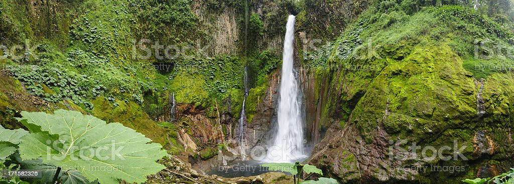 XXXL: Tropical waterfall in volcanic crater stock photo