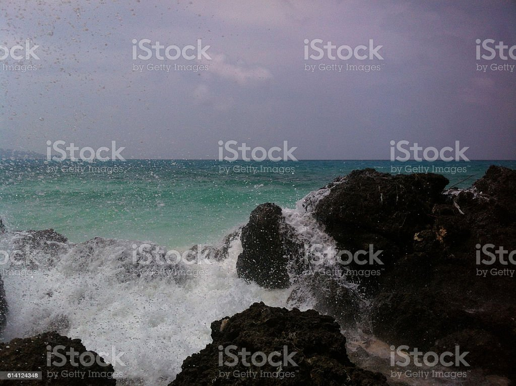 Tropical Waves Breaking Over Rocks stock photo