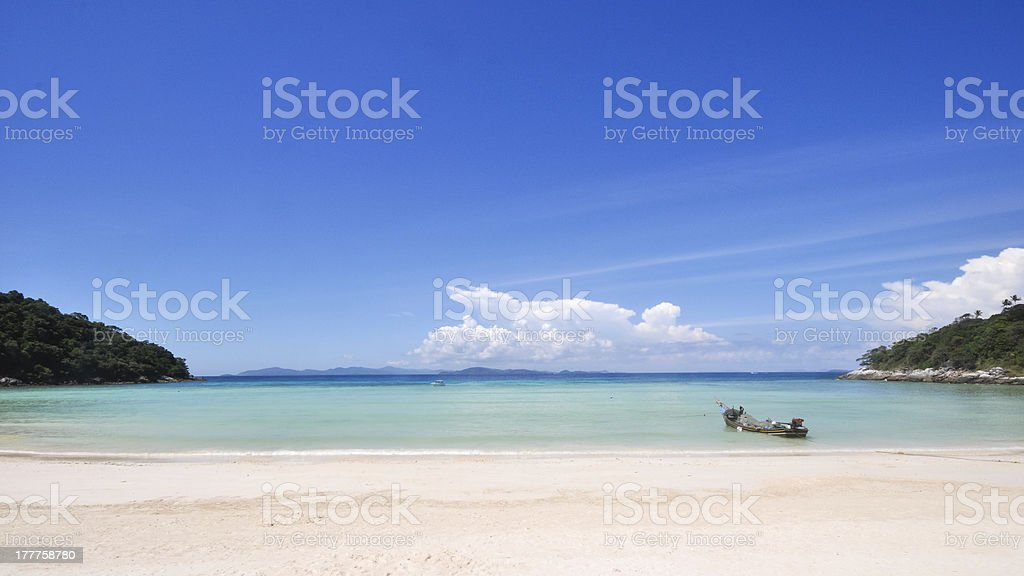tropical white sand beach and blue sky royalty-free stock photo