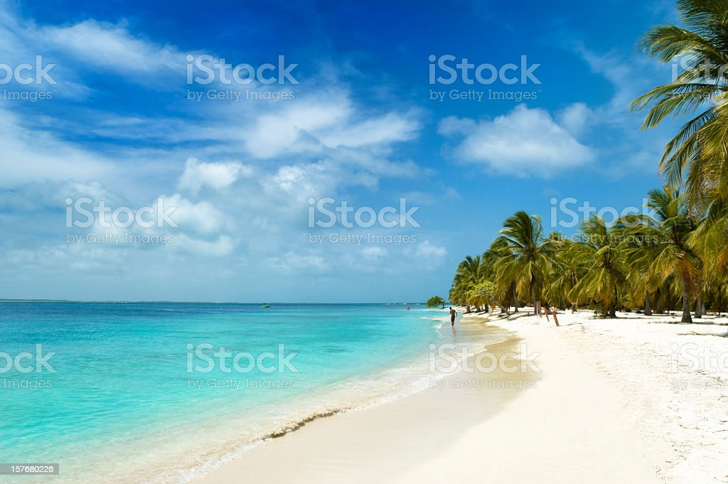 Tropical white sand island beach stock photo