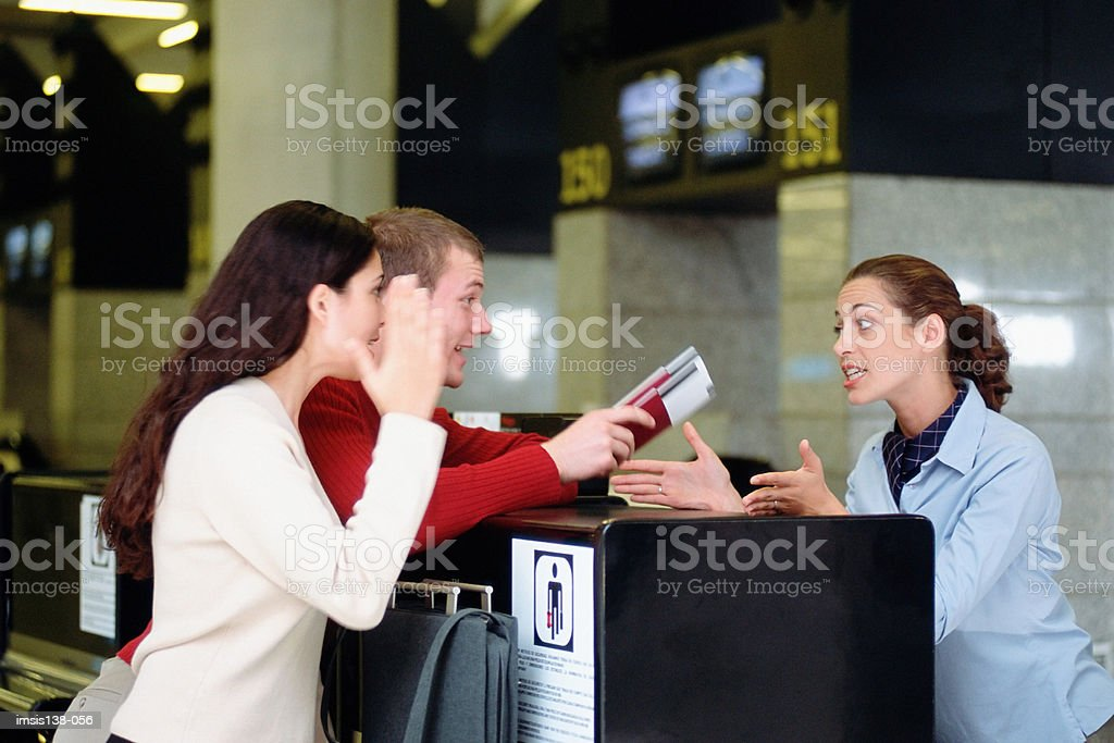 Trouble at the check-in desk stock photo