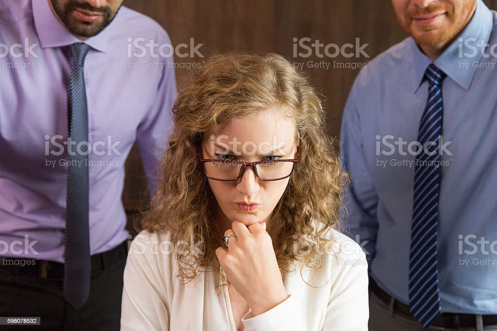 Troubled Businesswoman Sitting in Office and Thinking Over Repor stock photo