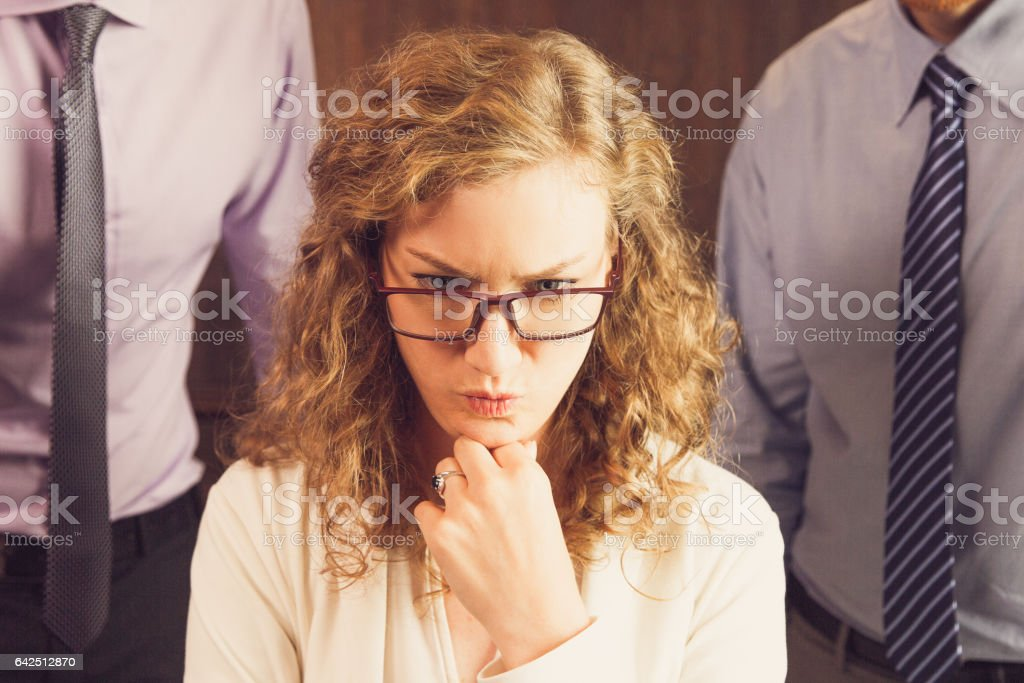 Troubled Businesswoman Thinking Over Idea stock photo
