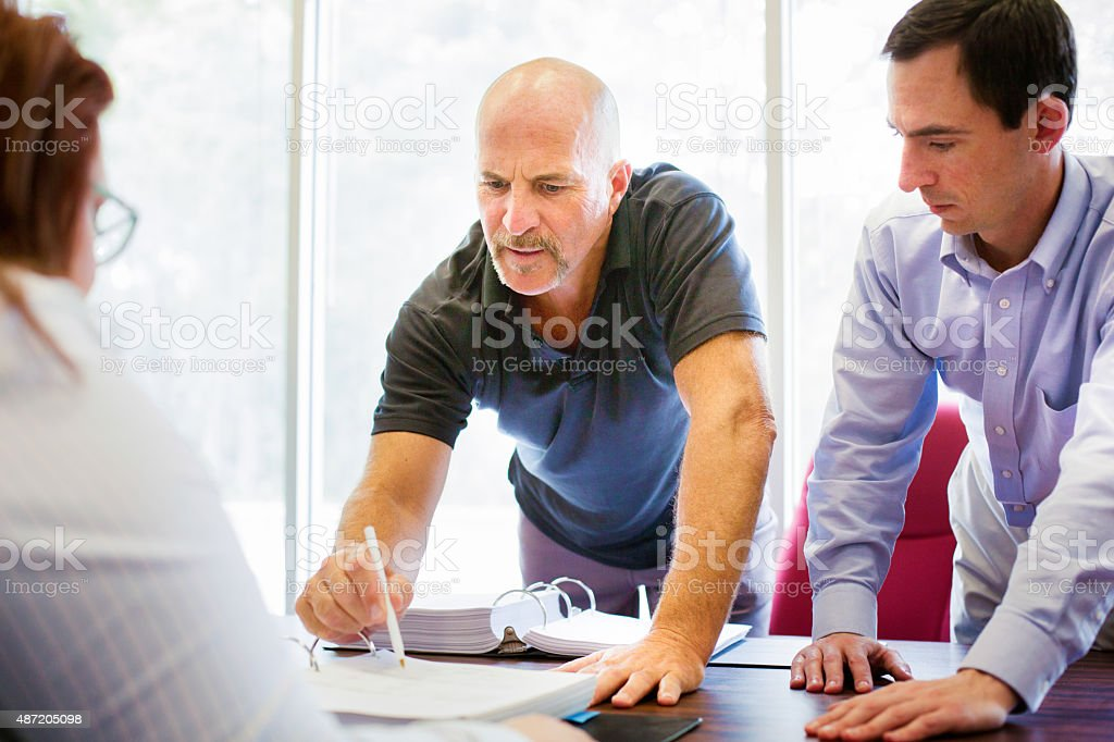 Troubled man pointing to small print on contract stock photo