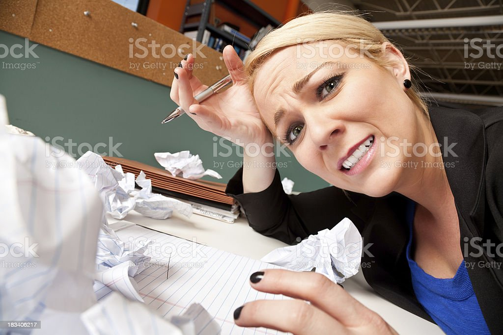 Troubled Worker at Office Cubicle With Waded Up Paper Everywhere royalty-free stock photo