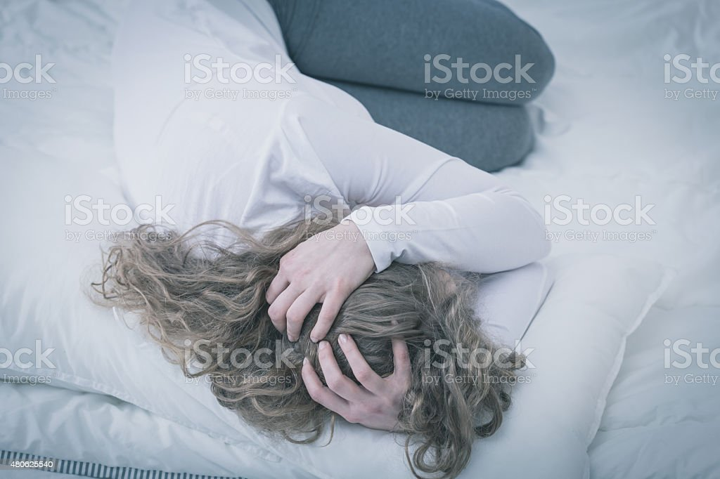 Troubled young woman stock photo