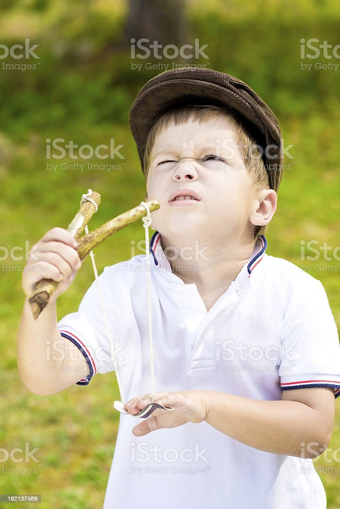 Troublemaker. Boy with slingshot royalty-free stock photo
