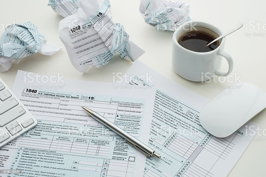 Troubles with filling 1040 US tax form stock photo
