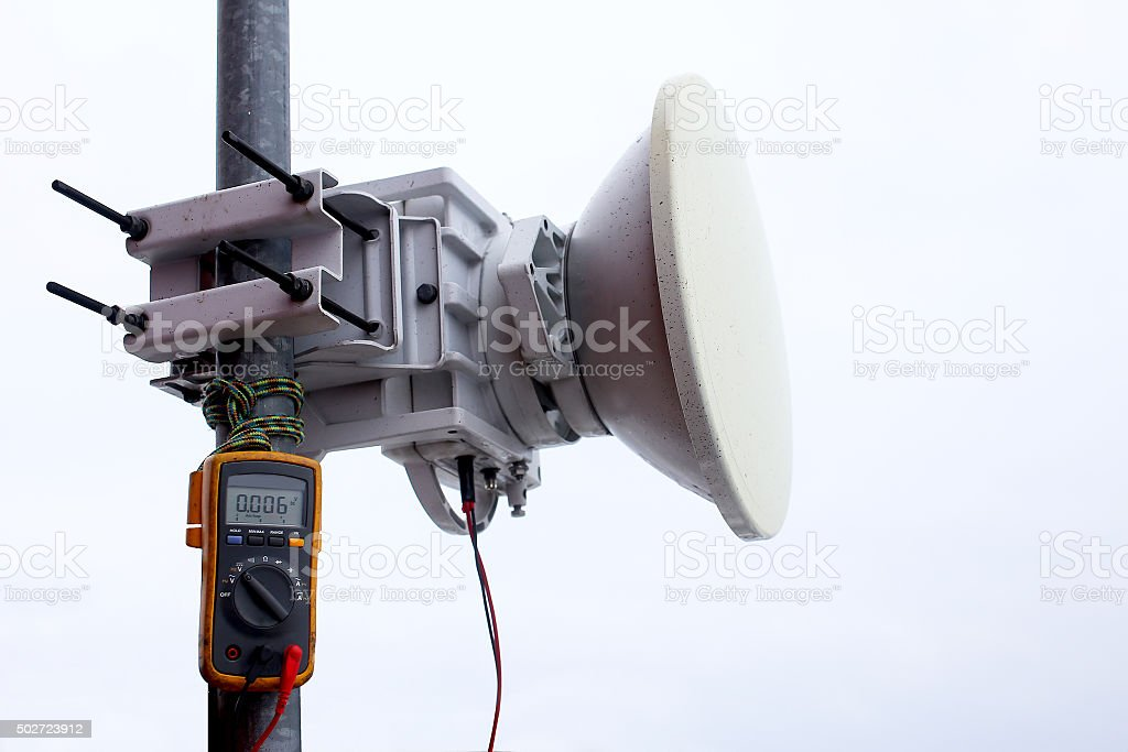 troubleshooting, measurement signal level at the mobile transceiver antenna stock photo