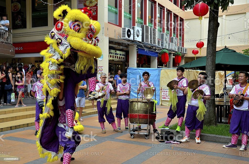Troupe performs Chinese lion dance, Singapore royalty-free stock photo