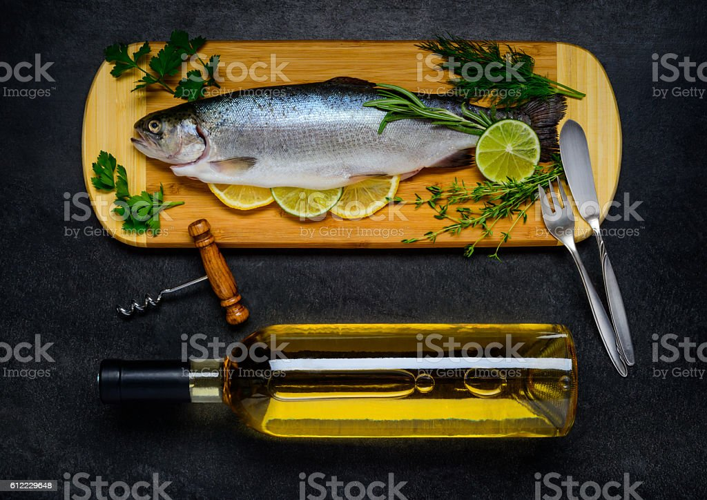 Trout Fish and Bottle of White Wine stock photo