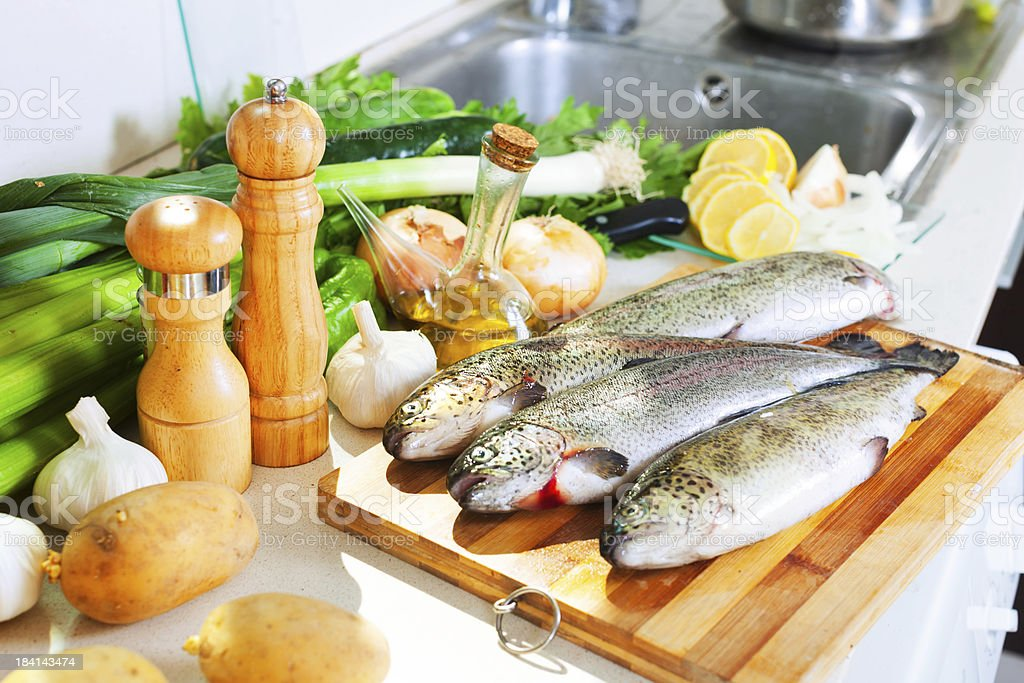 trout fish in home kitchen stock photo