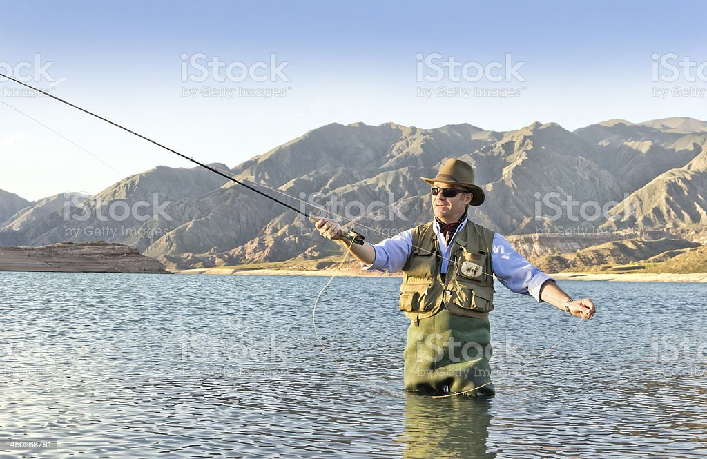 Trout fisherman stock photo