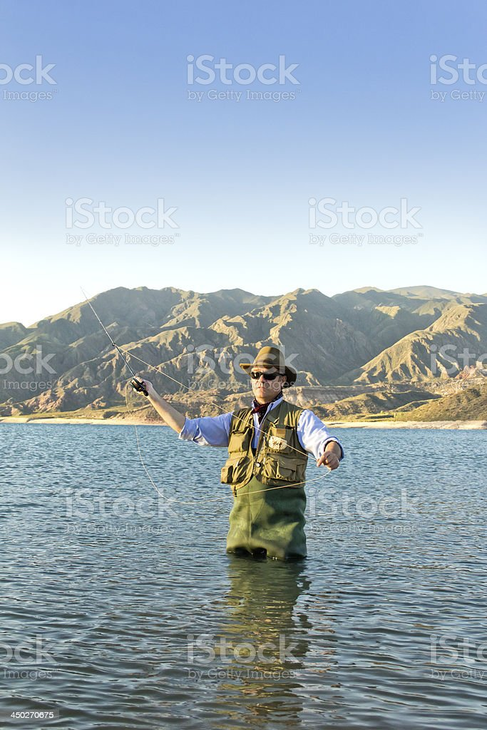 Trout fisherman royalty-free stock photo