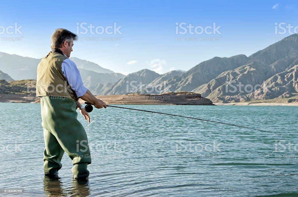 Trout fisherman stock photo