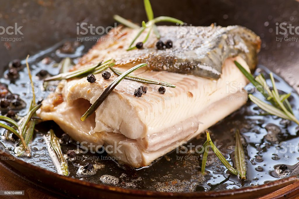Trout Fried in an Iron Pan stock photo