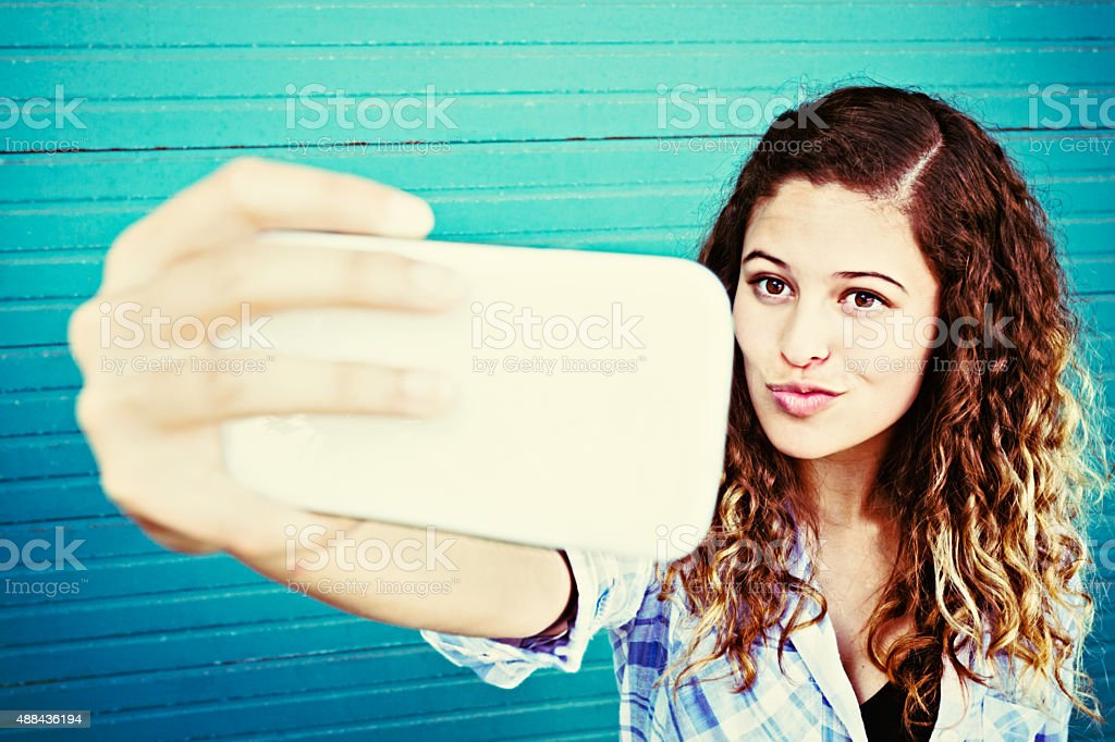 Trout pout selfie from cute teenage girl stock photo