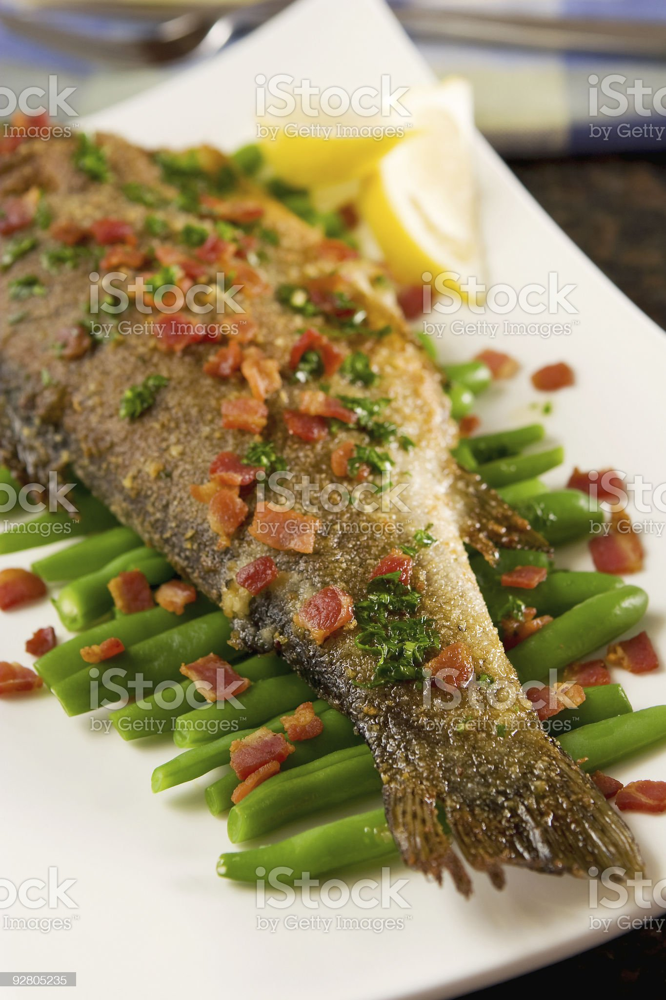 Trout with bacon and green beans royalty-free stock photo