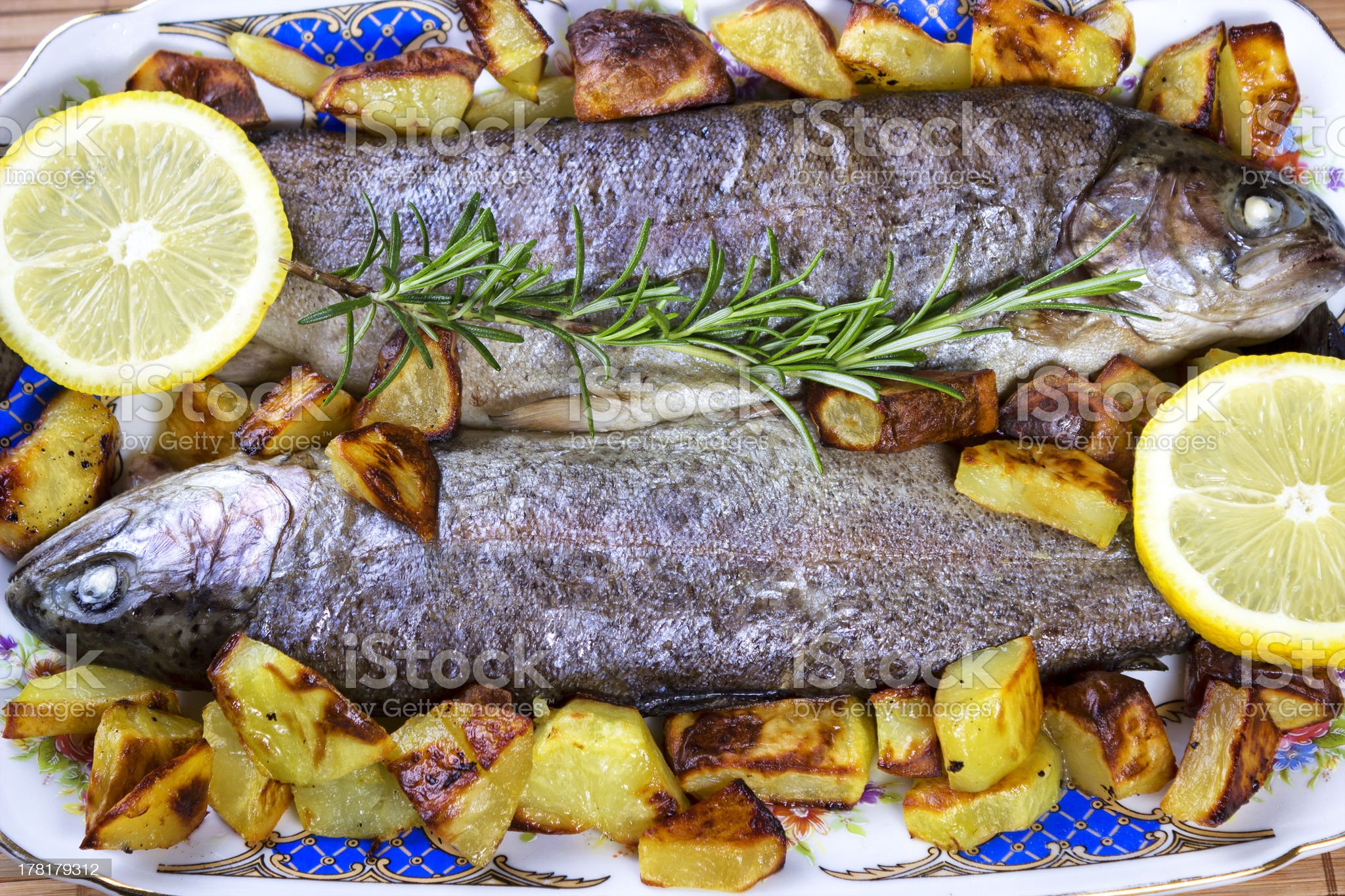 trout with grilled potatoes royalty-free stock photo