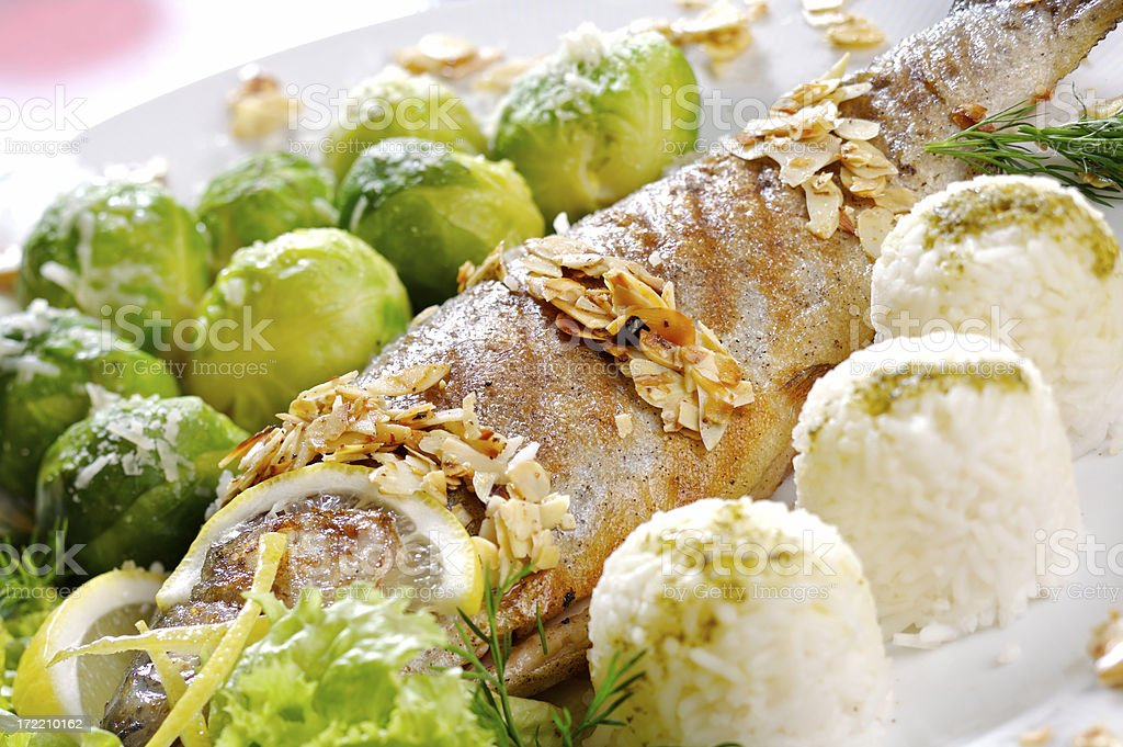 Trout with roasted almonds royalty-free stock photo