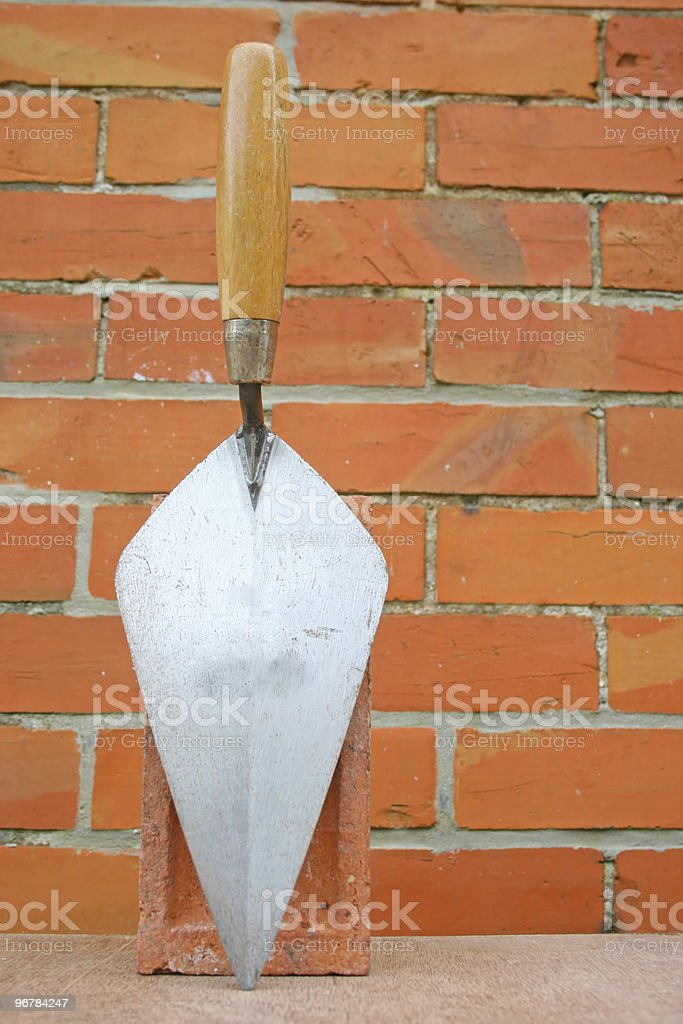 Trowel for laying bricks. stock photo