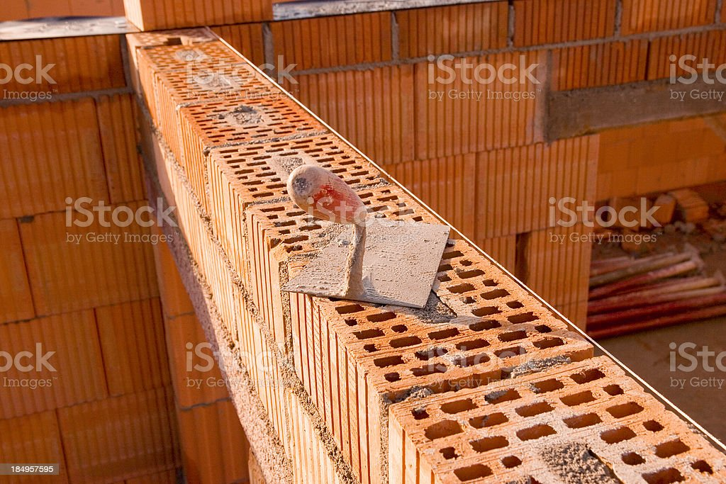 Trowel on Brick Wall royalty-free stock photo