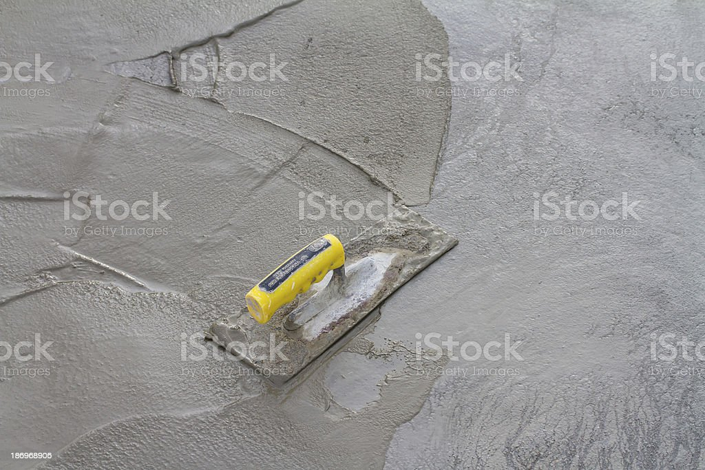 Trowel on fresh concrete at construction site stock photo