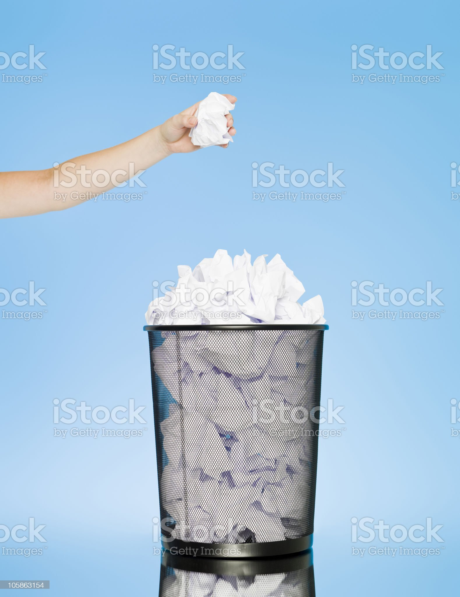 Trowing paper into a wastebasket royalty-free stock photo